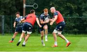 30 July 2020; Ciarán Frawley is tackled by Jack Conan, left, and Devin Toner, right, during Leinster Rugby squad training at UCD in Dublin. Professional rugby continues its return in a phased manner, having been suspended since March due to the Irish Government's efforts to contain the spread of the Coronavirus (COVID-19) pandemic. Having had zero positive results from the latest round of PCR testing, the Leinster Rugby players and staff have been cleared to enter the next phase of their return to rugby today which includes a graduated return to contact training. Photo by Conor Sharkey for Leinster Rugby via Sportsfile