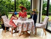 30 July 2020; Michelle Drysdale from Craughwell in Galway with her children Grace, aged nine, and Matthew, aged seven, play Monopoly in their outfits for the 2020 Galway Races Ladies' Day, which has now had to go virtual / online due to horse racing continuing behind closed doors on the advice of the Irish Government in an effort to contain the spread of the Coronavirus. Photo by Harry Murphy/Sportsfile