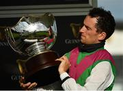 30 July 2020; Jockey Patrick Mullins celebrates with the trophy after victory in the Guinness Galway Hurdle Handicap on Aramon during day four of the Galway Summer Racing Festival at Ballybrit Racecourse in Galway. Horse racing remains behind closed doors to the public under guidelines of the Irish Government in an effort to contain the spread of the Coronavirus (COVID-19) pandemic. Photo by Harry Murphy/Sportsfile