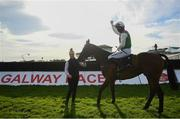 30 July 2020; Jockey Patrick Mullins celebrates with handler Rachel Boyd after victory in the Guinness Galway Hurdle Handicap on Aramon during day four of the Galway Summer Racing Festival at Ballybrit Racecourse in Galway. Horse racing remains behind closed doors to the public under guidelines of the Irish Government in an effort to contain the spread of the Coronavirus (COVID-19) pandemic. Photo by Harry Murphy/Sportsfile