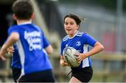 31 July 2020; Elouise Connolly, age 9, in action during a Bank of Ireland Leinster Rugby Summer Camp at Coolmine RFC in Dublin. Photo by Matt Browne/Sportsfile