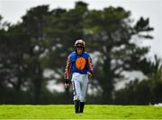 31 July 2020; JJ Slevin walks back to the weigh room after parting company with Risk Factor in the James's Gate Maiden Hurdle on day five of the Galway Summer Racing Festival at Ballybrit Racecourse in Galway. Horse racing remains behind closed doors to the public under guidelines of the Irish Government in an effort to contain the spread of the Coronavirus (COVID-19) pandemic. Photo by Harry Murphy/Sportsfile
