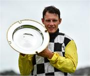 31 July 2020; Jockey Paul Townend lifts the Guinness Plate after winning the Guinness Galway Tribes Handicap Hurdle on Great White Shark on day five of the Galway Summer Racing Festival at Ballybrit Racecourse in Galway. Horse racing remains behind closed doors to the public under guidelines of the Irish Government in an effort to contain the spread of the Coronavirus (COVID-19) pandemic. Photo by Harry Murphy/Sportsfile