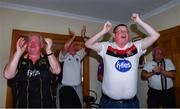 31 July 2020; Dundalk supporters, from left, Owen Fee, former co-owner Paul Brown, Ciaran McIntyre and Gerry Curtis, celebrate after Patrick Hoban of Dundalk scoreed their side's first goal as they watch their side's SSE Airtricity League Premier Division match against St Patrick's Athletic at the home of former Dundalk co-owner Paul Brown in Dundalk, Louth. The match was played behind closed doors due to the ongoing COVID-19 pandemic. Photo by Ben McShane/Sportsfile