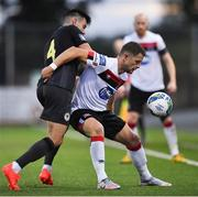 31 July 2020; Dane Massey of Dundalk in action against Dan Ward of St Patrick's Athletic during the SSE Airtricity League Premier Division match between Dundalk and St Patrick's Athletic at Oriel Park in Dundalk, Louth. The SSE Airtricity League Premier Division made its return today after 146 days in lockdown but behind closed doors due to the ongoing Coronavirus restrictions. Photo by Piaras Ó Mídheach/Sportsfile