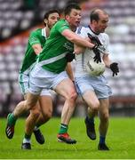 1 August 2020; Keith Ó Donnchadha of Mícheál Breathnach's is tackled by Gareth Bradshaw of Moycullen during the Galway County Senior Football Championship Group 2 Round 1 match between Moycullen and Mícheál Breathnach's at Pearse Stadium in Galway. GAA matches continue to take place in front of a limited number of people in an effort to contain the spread of the Coronavirus (COVID-19) pandemic. Photo by Piaras Ó Mídheach/Sportsfile