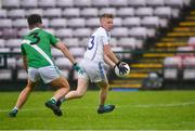 1 August 2020; Liam Ó Conghaile of Mícheál Breathnach's in action against Sean Kelly of Moycullen during the Galway County Senior Football Championship Group 2 Round 1 match between Moycullen and Mícheál Breathnach's at Pearse Stadium in Galway. GAA matches continue to take place in front of a limited number of people in an effort to contain the spread of the Coronavirus (COVID-19) pandemic. Photo by Piaras Ó Mídheach/Sportsfile
