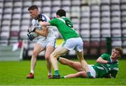 1 August 2020; Ronan Mac Donnacha of Mícheál Breathnach's in action against Aidan Claffey, 6, and James McLoughlin of Moycullen during the Galway County Senior Football Championship Group 2 Round 1 match between Moycullen and Mícheál Breathnach's at Pearse Stadium in Galway. GAA matches continue to take place in front of a limited number of people in an effort to contain the spread of the Coronavirus (COVID-19) pandemic. Photo by Piaras Ó Mídheach/Sportsfile