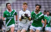 1 August 2020; Liam Ó Conghaile of Mícheál Breathnach's in action against Tomas Gilson, right, and Max Payton of Moycullen during the Galway County Senior Football Championship Group 2 Round 1 match between Moycullen and Mícheál Breathnach's at Pearse Stadium in Galway. GAA matches continue to take place in front of a limited number of people in an effort to contain the spread of the Coronavirus (COVID-19) pandemic. Photo by Piaras Ó Mídheach/Sportsfile