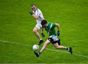 1 August 2020; David Wynne of Moycullen in action against Caoimhín Ó Maoileoin of Mícheál Breathnach's during the Galway County Senior Football Championship Group 2 Round 1 match between Moycullen and Mícheál Breathnach's at Pearse Stadium in Galway. GAA matches continue to take place in front of a limited number of people in an effort to contain the spread of the Coronavirus (COVID-19) pandemic. Photo by Piaras Ó Mídheach/Sportsfile