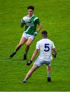 1 August 2020; Seán Kelly of Moycullen in action against Dinny Ó hÉallaithe of Mícheál Breathnach's during the Galway County Senior Football Championship Group 2 Round 1 match between Moycullen and Mícheál Breathnach's at Pearse Stadium in Galway. GAA matches continue to take place in front of a limited number of people in an effort to contain the spread of the Coronavirus (COVID-19) pandemic. Photo by Piaras Ó Mídheach/Sportsfile