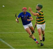1 August 2020; Brian Moylan of Glen Rovers handpasses to a team-mate despite the efforts of Brian Hayes of St. Finbarrs during the Cork County Senior Hurling Championship Group C Round 1 match between Glen Rovers and St. Finbarrs at Páirc Uí Chaoimh in Cork. GAA matches continue to take place in front of a limited number of people due to the ongoing Coronavirus restrictions. Photo by Brendan Moran/Sportsfile