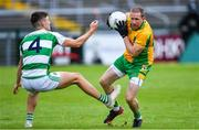 2 August 2020; Gary Sice of Corofin in action against James Webb of Oughterard during the Galway County Senior Football Championship Group 4A Round 1 match between Corofin and Oughterard at Pearse Stadium in Galway. GAA matches continue to take place in front of a limited number of people due to the ongoing Coronavirus restrictions. Photo by Piaras Ó Mídheach/Sportsfile