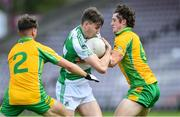 2 August 2020; Matthew Tierney of Oughterard in action against Ross Mahon, left, and Kieran Molloy of Corofin during the Galway County Senior Football Championship Group 4A Round 1 match between Corofin and Oughterard at Pearse Stadium in Galway. GAA matches continue to take place in front of a limited number of people due to the ongoing Coronavirus restrictions. Photo by Piaras Ó Mídheach/Sportsfile