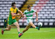 2 August 2020; Ryan Monaghan of Oughterard in action against Kieran Molloy of Corofin during the Galway County Senior Football Championship Group 4A Round 1 match between Corofin and Oughterard at Pearse Stadium in Galway. GAA matches continue to take place in front of a limited number of people due to the ongoing Coronavirus restrictions. Photo by Piaras Ó Mídheach/Sportsfile