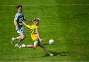2 August 2020; Matthew Cooley of Corofin on his way to scoring side's seventh goal as Ciarán Hanley of Oughterard closes in during the Galway County Senior Football Championship Group 4A Round 1 match between Corofin and Oughterard at Pearse Stadium in Galway. GAA matches continue to take place in front of a limited number of people due to the ongoing Coronavirus restrictions. Photo by Piaras Ó Mídheach/Sportsfile