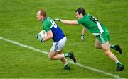 2 August 2020; Keith Cribbin of Johnstownbridge in action against Barry Coffey of Sarsfields during the Kildare Senior Football Championship Group C Round 1 match between Sarsfields and Johnstownbridge at St. Conleth's Park in Newbridge, Kildare. GAA matches continue to take place in front of a limited number of people due to the ongoing Coronavirus restrictions. Photo by Brendan Moran/Sportsfile