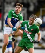 2 August 2020; Gary White of Sarsfields in action against Shane Flynn of Johnstownbridge during the Kildare Senior Football Championship Group C Round 1 match between Sarsfields and Johnstownbridge at St. Conleth's Park in Newbridge, Kildare. GAA matches continue to take place in front of a limited number of people due to the ongoing Coronavirus restrictions. Photo by Brendan Moran/Sportsfile