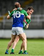 2 August 2020; Barry Coffey of Sarsfields and Eoin O'Donoghue of Johnstownbridge tussle off the ball during the Kildare Senior Football Championship Group C Round 1 match between Sarsfields and Johnstownbridge at St. Conleth's Park in Newbridge, Kildare. GAA matches continue to take place in front of a limited number of people due to the ongoing Coronavirus restrictions. Photo by Brendan Moran/Sportsfile