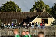 2 August 2020; Supporters sit on a wall outside the ground while watching the Kildare Senior Football Championship Group C Round 1 match between Sarsfields and Johnstownbridge at St. Conleth's Park in Newbridge, Kildare. GAA matches continue to take place in front of a limited number of people due to the ongoing Coronavirus restrictions. Photo by Brendan Moran/Sportsfile