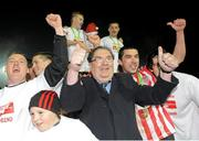 30 October 2010; John Hume, SDLP founder and co-recipient of the 1998 Nobel Peace Prize, celebrates with Derry City players after winning the Airtricity League First Division following their match against Monaghan United at Gortakeegan in Monaghan. Photo by Oliver McVeigh/Sportsfile