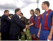 12 August 2003; John Hume, MP & MEP, meets Barcelona players prior to the the friendly match between Derry City and Barcelona at the Brandywell Stadium in Derry. Photo by David Maher/Sportsfile