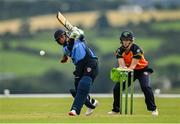 3 August 2020; Amy Hunter of Typhoons plays a shot, watched by Scorchers wicker-keeper Shauna Kavanagh, during the Women's Super Series match between Typhoons and Scorchers at Oak Hill Cricket Ground in Kilbride, Wicklow. Photo by Seb Daly/Sportsfile