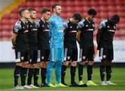 3 August 2020; Derry City players observe a minutes silence in tribute to the late Derry native John Hume, key architect of the Good Friday Agreement and co-recipient of the 1998 Nobel Peace Prize, prior to the SSE Airtricity League Premier Division match between St Patrick's Athletic and Derry City at Richmond Park in Dublin. Photo by Stephen McCarthy/Sportsfile