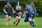 4 August 2020; Scott Penny, centre, and Garry Ringrose during Leinster Rugby squad training at UCD in Dublin. Professional rugby continues its return in a phased manner, having been suspended since March due to the ongoing Coronavirus restrictions. Having had zero positive results from the latest round of PCR testing, the Leinster Rugby players and staff have been cleared to enter the next phase of their return to rugby today which includes a graduated return to contact training. Photo by Ramsey Cardy/Sportsfile