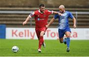 4 August 2020; Ryan Brennan of Shelbourne in action against Mark Coyle of Finn Harps during the SSE Airtricity League Premier Division match between Finn Harps and Shelbourne at Finn Park in Ballybofey, Donegal. Photo by Harry Murphy/Sportsfile