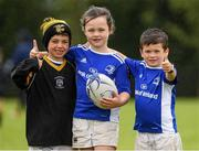 5 August 2020; Allice McCann, age 7, with her brother Sean, right, age 6, and cousin Ethan McCann, age 7, during the Bank of Ireland Leinster Rugby Summer Camp at Newbridge in Kildare. Photo by Matt Browne/Sportsfile