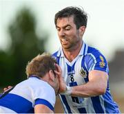 5 August 2020; Michael Darragh Macauley of Ballyboden St Endas blocks the attack of Nathan Mullins of St Vincent's during the Dublin County Senior Football Championship Round 2 match between St Vincent's and Ballyboden St Endas at Pairc Naomh Uinsionn in Marino, Dublin. Photo by Stephen McCarthy/Sportsfile