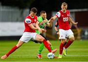 7 August 2020; Alex Kolger of Finn Harps in action against Luke McNally, left, and Jamie Lennon of St Patrick's Athletic during the SSE Airtricity League Premier Division match between St Patrick's Athletic and Finn Harps at Richmond Park in Dublin. Photo by Seb Daly/Sportsfile