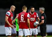 7 August 2020; St Patrick's Athletic players, from left, Georgie Kelly, Jamie Lennon and Robbie Benson remonstrate with referee Sean Grant during the SSE Airtricity League Premier Division match between St Patrick's Athletic and Finn Harps at Richmond Park in Dublin. Photo by Seb Daly/Sportsfile