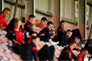 7 August 2020; Injured Bohemians player Danny Mandroiu sits with team-mates prior to the SSE Airtricity League Premier Division match between Bohemians and Dundalk at Dalymount Park in Dublin. Photo by Stephen McCarthy/Sportsfile