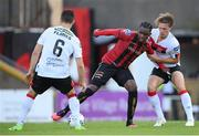 7 August 2020; Andre Wright of Bohemians in action against Daniel Cleary, right, and Jordan Flores of Dundalk during the SSE Airtricity League Premier Division match between Bohemians and Dundalk at Dalymount Park in Dublin. Photo by Stephen McCarthy/Sportsfile