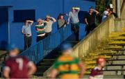 8 August 2020; Supporters shield their eyes from the sun as they watch the Tipperary County Senior Hurling Championship Group 4 Round 2 match between Borris-Ileigh and Burgess at McDonagh Park in Nenagh, Tipperary. Photo by Piaras Ó Mídheach/Sportsfile