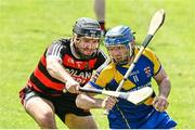 9 August 2020; Jamie Ryan of Loughrea is tackled by Alan Loughnane of Cappataggle during the Galway County Senior Hurling Championship Group 1 match between Cappataggle and Loughrea at Duggan Park in Ballinasloe, Galway. Photo by Ramsey Cardy/Sportsfile