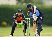 9 August 2020; Louise Little of Typhoons plays a shot as Shauna Kavanagh of Scorchers watches on during the Women's Super Series match between Scorchers and Typhoons at Pembroke Cricket Club in Park Avenue, Dublin. Photo by Sam Barnes/Sportsfile