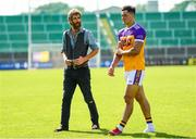 9 August 2020; Former Wexford hurler Diarmuid Lyng speaks with Lee Chin of Faythe Harriers following the Wexford County Senior Hurling Championship Quarter-Final match between Faythe Harriers and Shelmaliers at Chadwicks Wexford Park in Wexford. Photo by Harry Murphy/Sportsfile