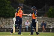 9 August 2020; Gaby Lewis, left, and Leah Paul of Scorchers bump fists during the Women's Super Series match between Scorchers and Typhoons at Pembroke Cricket Club in Park Avenue, Dublin. Photo by Sam Barnes/Sportsfile