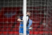 9 August 2020; A member of the the Ryan McBride Brandywell Stadium staff cleans the goalposts at half-time of the SSE Airtricity League Premier Division match between Derry City and Shamrock Rovers at Ryan McBride Brandywell Stadium in Derry. Photo by Stephen McCarthy/Sportsfile