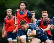 10 August 2020; Garry Ringrose is tackled by Ciarán Frawley during Leinster Rugby squad training at UCD in Dublin. Photo by Ramsey Cardy/Sportsfile