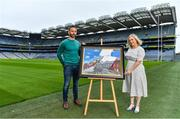12 August 2020; A picture paints 100 words: Artist David Sweeney, who is a former Dublin senior hurling captain and eLearning Manager at Croke Park, shows his specially commissioned Bloody Sunday commemoration artwork to GAA Museum Education & Events Manager, Julianne McKeigue, a descendent of Tipperary footballer Michael Hogan who was killed during the Bloody Sunday attack, at the launch of the GAA Museum's Bloody Sunday centenary events series. For a full list of events over the coming months visit www.crokepark.ie/bloodysunday. Photo by Brendan Moran/Sportsfile