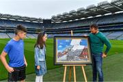 12 August 2020; A picture paints 100 words: Artist David Sweeney, who is a former Dublin senior hurling captain and eLearning Manager at Croke Park, shows his specially commissioned Bloody Sunday commemoration artwork to Caoimhín Fay, from Phibsboro, in Dublin, and Amelie Hughes, from Fairview, in Dublin, at the launch of the GAA Museum's Bloody Sunday centenary events series. For a full list of events over the coming months visit www.crokepark.ie/bloodysunday Photo by Brendan Moran/Sportsfile