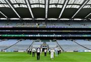12 August 2020; The GAA Museum Remembers Bloody Sunday tragedy: The team at the GAA Museum remember the 14 victims who lost their lives in the Bloody Sunday tragedy 100 years on at the launch of the GAA Museum's Bloody Sunday centenary events series at Croke Park. Pictured here are, back row, from left, Croke Park Tour Guide Aran O'Reilly, Croke Park Chief Steward Mick Leddy, Alannah Behan from Glasnevin in Dublin, Tipperary footballer Bill Maher, Uachtarán Chumann Lúthchleas Gael John Horan, Dr. Siobhán Doyle of TU Dublin, Director of the GAA Museum Niamh McCoy, Croke Park Tour Guide Martin Healy, GAA Museum Education & Events Manager, Julianne McKeigue, a descendent of Tipperary footballer Michael Hogan who was killed during the Bloody Sunday attack, Artist David Sweeney, Dublin footballer Michael Darragh MacAuley, Michael McLoughlin of Glasnevin in Dublin, Croke Park Deputy Chief Steward Mairead O'Carroll and Croke Park Tour Guide Gerry McGarry all holding drawings of the 14 victims of the tragedy. For a full list of events over the coming months visit www.crokepark.ie/bloodysunday. Photo by Harry Murphy/Sportsfile