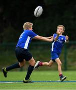 13 August 2020; Conor Stafford is tackled by Ryan O'Dowd during the Bank of Ireland Leinster Rugby Summer Camp at Clontarf RFC in Dublin. Photo by Eóin Noonan/Sportsfile