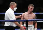 14 August 2020; Eric Donovan is given a count by referee Howard Foster during the IBF Inter-Continental Super Feather Title bout against Zelfa Barrett at the Matchroom Fight Camp in Brentwood, England. Photo by Mark Robinson / Matchroom Boxing via Sportsfile