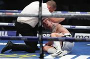 14 August 2020; Referee Howard Foster stops the fight in the 8th round after Eric Donovan was knocked out by Zelfa Barrett during their IBF Inter-Continental Super Feather Title bout at the Matchroom Fight Camp in Brentwood, England. Photo by Mark Robinson / Matchroom Boxing via Sportsfile
