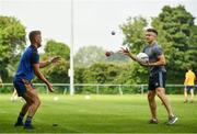 15 August 2020; Jonny Cooper, left, and Eoin Murchan of Na Fianna warm up prior to the Dublin County Senior 1 Football Championship Group 2 Round 3 match between Na Fianna and Ballinteer St Johns at Balgriffin in Dublin. Photo by David Fitzgerald/Sportsfile